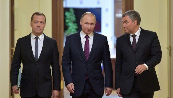 (L-R) Dmitry Medvedev, State Duma Speaker Vyacheslav Volodin, and President Vladimir Putin walk before a session of the State Duma.