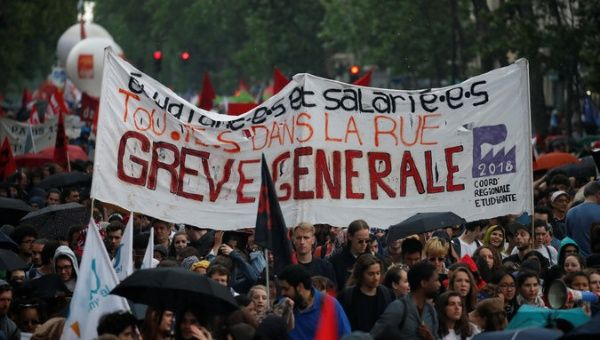 French civil servants and students carry labour union flags and banners as they march in protest during a national day of strikes by public sector workers.