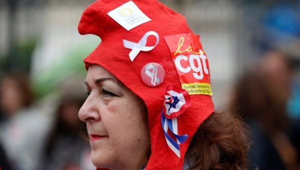 A French civil servant wears a CGT labour union sticker during a national day of strikes by public sector workers in Marseille