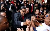 Venezuela's re-elected President Nicolas Maduro greets his supporters as he leaves after receiving a certificate confirming him as winner of Sunday's election at the National Electoral Council (CNE) in Caracas, Venezuela May 22, 2018.