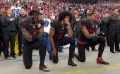 San Francisco 49ers Eli Harold (58), Colin Kaepernick (7) and Eric Reid (35) kneel in protest during the playing of the national anthem before an NFL game.