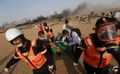 Paramedics evacuate a wounded man in Gaza.