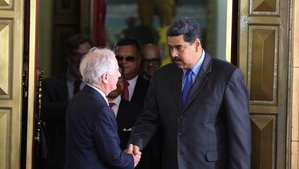 President Nicolas Maduro greets United States SenatorBob Corker.