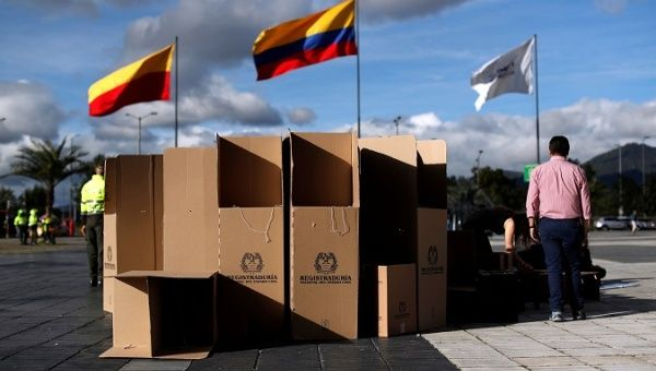 People assemble voting booths for the May 27 presidential election, in Bogota, Colombia May 26, 2018.