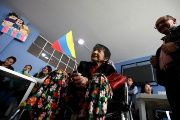 A woman holds a national flag at a polling station as Colombians vote for a new president in Bogota, Colombia, May 27, 2018.