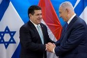 Paraguayan President Horacio Cartes shakes hands with Israeli Prime Minister Benjamin Netanyahu during a meeting at the Prime Minister's office in Jerusalem.