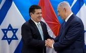 Paraguayan President Horacio Cartes shakes hands with Israeli Prime Minister Benjamin Netanyahu during a meeting at the Prime Minister