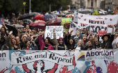 Demonstrators take part in a protest to urge the Irish to repeal the 8th amendment to the constitution relating to woman