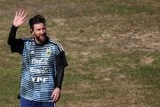 Lionel Messi of Argentina waves to the fans during a training session