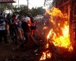 Protesters burn a public radio station in Managua, Nicaragua, May 30, 2018.