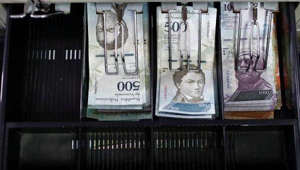 Venezuelan bolivar notes are pictured in an open cash register at a parking lot in Caracas, Venezuela in May 2018.