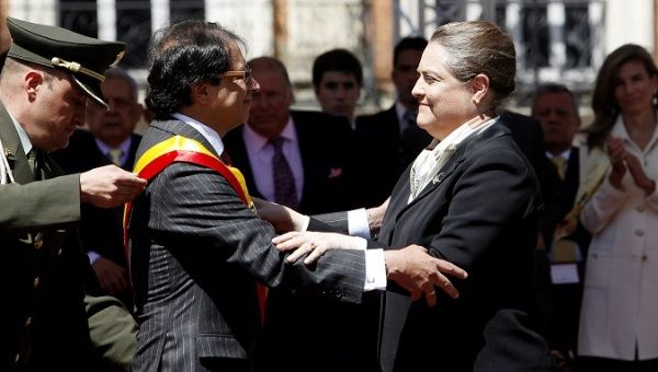 Then mayor-elect Gustavo Petro getting the sash from acting mayor Clara Lopez during the swearing in ceremony in Bogota.