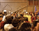 Activists celebrate around Yaku Perez, Ecuarunari president, on Friday night in Cuenca after a judge ruled to suspend mining activities at the Junefield Rio Blanco site.