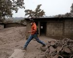 A man walks through an area affected by eruption from Fuego volcano in the community of San Miguel Los Lotes in Escuintla, Guatemala June 4, 2018.