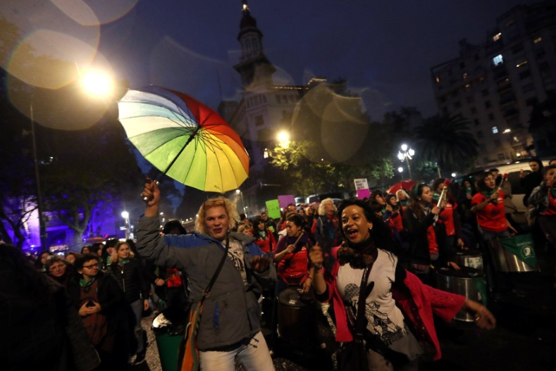 Demonstrators dance and shout slogans during a protest against femicides and violence against women in Buenos Aires.