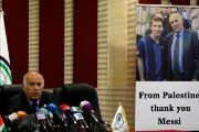 A poster of Palestinian FA chief Jibril Rajoub with Argentina's soccer player Messi is seen during Rajoub's news conference, in Ramallah, West Bank.