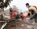 Residents shovel ashes in search of victims' remains in Guatemala following the deadly volcanic eruptions.