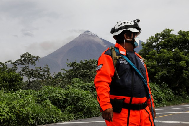The Fuego volcano spews out a plume of ash and smoke as seen from El Rodeo in Escuintla, Guatemala on June 8.