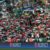 Celtic FC fans fly Palestinian flags in solidarity with Palestine.