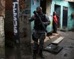 A military policeman patrols the Kelson favela during an operation in Rio de Janeiro, Brazil.