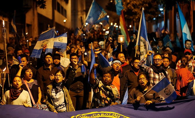 Demonstrators take part in a protest against the Guatemalan government's disaster agency, in Guatemala City, Guatemala June 9, 2018.