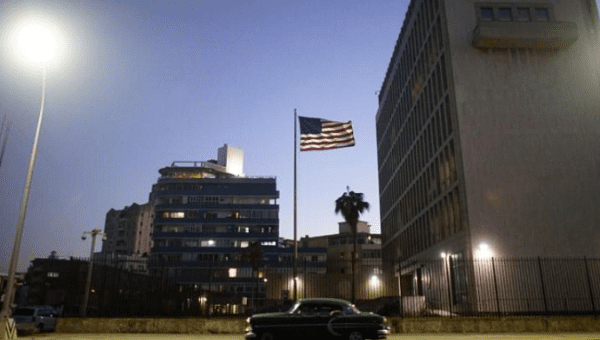 A vintage car passes by in front of the U.S. Embassy in Havana, Cuba, January 12, 2017