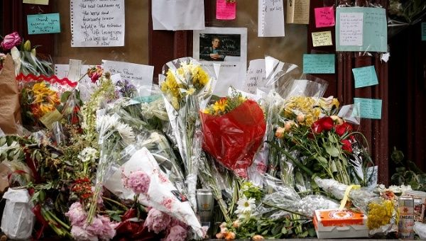 Tributes to chef and television personality Anthony Bourdain are placed outside Brasserie Les Halles in New York, U.S., June 11, 2018.