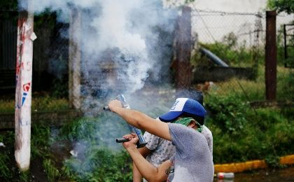 A demonstrator holds a homemade mortar during a protest against Nicaraguan President Daniel Ortega