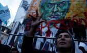 A demonstrator shouts slogans during a protest against the economic measures taken by Argentine President Mauricio Macri