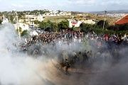 Israeli forces face Jewish settler protesters during a court-ordered demolition on Palestinian-owned land.