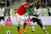 Russia's Fedor Smolov and France's N'Golo Kante compete in a friendly match before the World Cup.