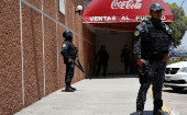 Police guard the Coca-Cola distribution plant after it closed due to violence in Ciudad Altamirano in Guerrero, Mexico, April 2018.