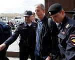 Veteran British LGBT rights campaigner Peter Tatchell is detained by police officers in central Moscow, Russia, June 14, 2018.