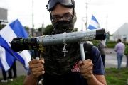 A demonstrator holds a homemade mortar during a protest against the government of Nicaragua's President Daniel Ortega, in Managua, Nicaragua June 17 2018.