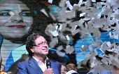 Presidential candidate Gustavo Petro is showered with confetti as he addresses supporters after being defeated by Ivan Duque in Colombia