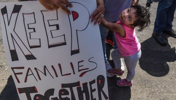 People participate in a protest against the recent U.S. immigration policy of separating children from their families in Elizabeth, NJ, U.S., June 17, 2018.