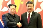 North Korean leader Kim Jong-un (L), pictured with Xi Jinping, will make a three-day China trip.