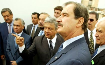 File Photo: Mexico City mayor Andres Manuel Lopez Obrador (C) points as Mexican President Vicente Fox (R) listens during a tour of a project to rejuvenate the capital