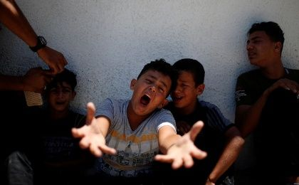 The brother of a Palestinian, who was killed at the Israel-Gaza border, reacts at a hospital in Gaza City June 18, 2018.