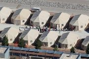 Immigrant children are shown walking in single file between tents in their compound next to the Mexican border in Tornillo, Texas, U.S. June 18, 2018.