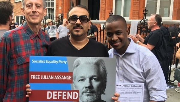 Human rights campaigner Peter Tatchell (L) with demonstrators outside London