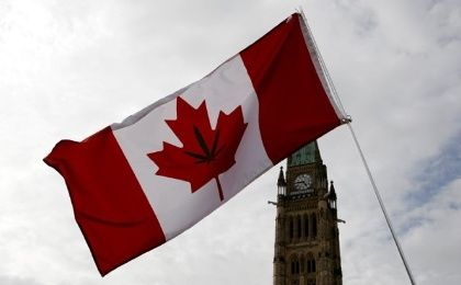 A Canadian flag with a marijuana leaf on it is seen during the annual 4/20 marijuana rally on Parliament Hill in Ottawa, Ontario, Canada, April 20, 2017