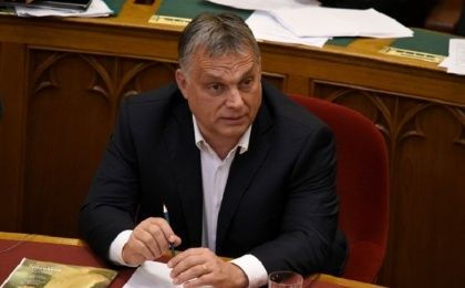 Hungarian Prime Minister Viktor Orban sits before vote on the