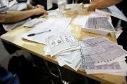 Officials count ballots in Colombia's presidential elections, which have been marred by allegations of fraud.