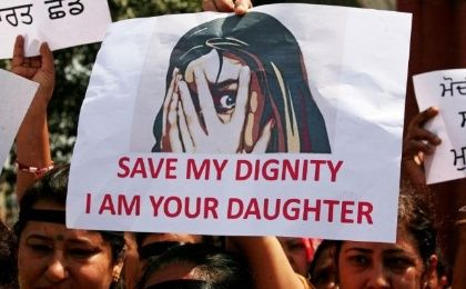 People participate in a protest against the rape of an eight-year-old girl in India.