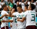 Mexico's Javier Hernandez celebrates scoring their second goal with Carlos Salcedo and teammates.