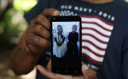 A Salvadoran immigrant, Arnovis Guido Portillo shows a picture of his daughter Maybelline Guido, 6, who he lost contact with after being deported from the U.S. in 2018.