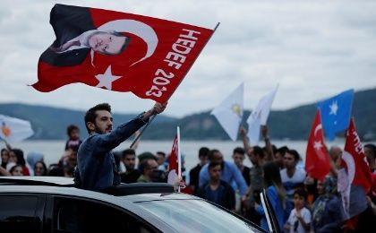 AKP Party, Erdogan supporters wave flags outside the Tarabya mansion in Istanbul, Turkey June 24, 2018.