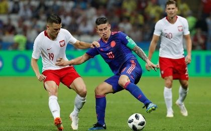 Soccer Football - World Cup - Group H - Poland vs Colombia - Kazan Arena, Kazan, Russia - June 24, 2018 Colombia's James Rodriguez in action with Poland's Piotr Zielinski
