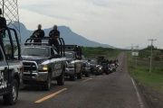 The Michoacan state police force ride in to arrest all 28 members of the Ocampo municipal police force.